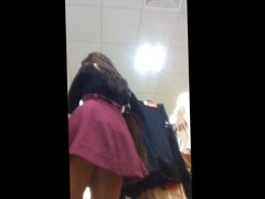 Hot brunette lady upskirted in store