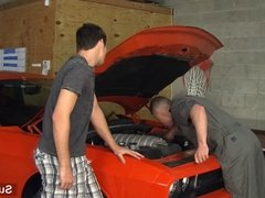 Sexy gay mechanic gets fucked in the garage