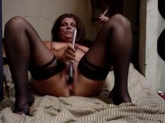 Hot Older Cougar in Stockings and Heels Smoking and Diddling