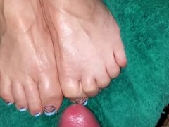 cumming on her lubed up pedicured toes
