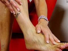 Naughty American housewife playing with her feet and pussy