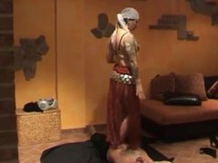 Belly Dancing on stomach (trampling barefoot and in heels)