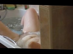 Big titted and bellied wife in the bath