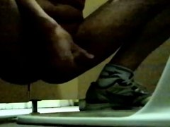 Masturbating in a public toilet wearing nothing but sneakers