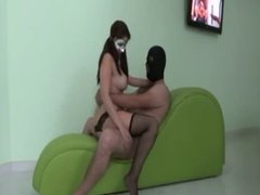Hot brunette rides guy on a chair