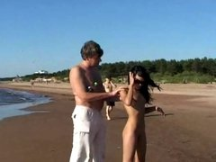 This teen nudist strips bare at a public beach