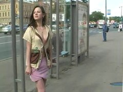 Naughty in public Brunette flashing at the crowde bus stop