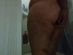Chub fucks 8in Black Dildo in shower