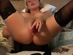 Sexy blonde playing with toys for camera