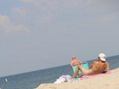Sunny day on public nude beach