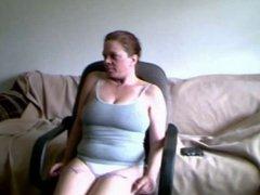 Chubby slut masturbates on chair