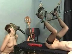 Dark Hair Mistress and haer slaves