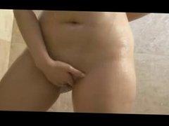 Brunette masturbating in the shower