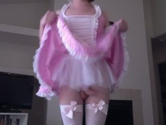 Sissy boy in pink dress bends over
