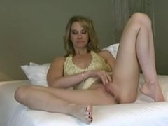 Horny milf satisfies herself with big dildo