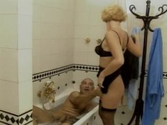 Maids give their boss his daily bath