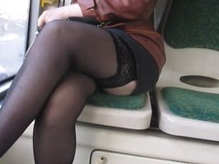 Chick flashing stockings tops in a bus