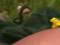 Jenni Relaxing On The Green Grass