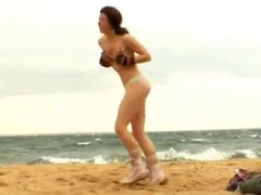 Sexy Teen strips naked on a windy beach