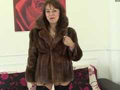 One dirty granny in fur coat
