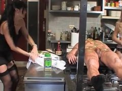 Bad chef gets strapon fucked by rough dominas