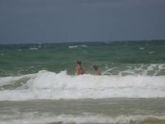 Daniela Hantuchova in a bikini riding the waves