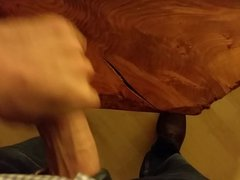Jacking off on coffee table