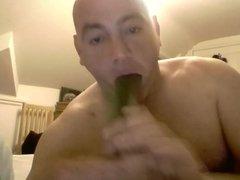 Dirty old man sucking a cucumber