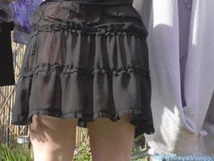 hanging washing in a see-thru dress.