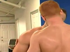 Muscle man and Young redhead