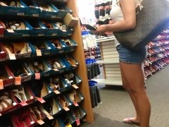 Candid blond searching for shoes