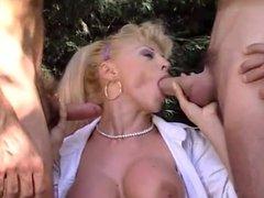 blonde milf takes two cocks