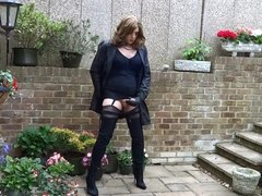 Alison wanking in her new nylon mac and thigh boots