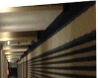 Sexy Milf In Heels Walking Naked In Motel Hallway