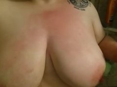 Slapping her tits