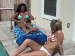 Blonde licking black feet by the pool