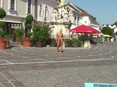 Naughty blonde babe shows her boobs on public streets