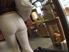 Beautiful big ass brunette in tight white jeans