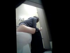 Cute Girl Sits Down on the Toilet