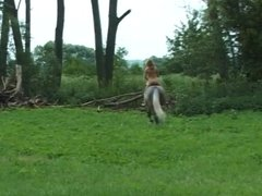 Naked in the field.