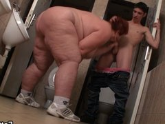Massive tits fatty takes it in the restroom