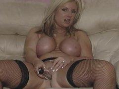 British slut plays with herself in fishnets