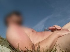 Wanking and cumming at the nude beach