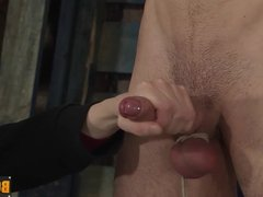 Tim's scrotum is tight and his big cock is stroked endlessly