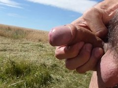 Wanking uncut cock shaved balls public field cumming