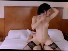 Hot brunette in stockings rides her boyfriend's dick in bed