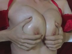 Long dick gets handjob with two hands by busty brunette