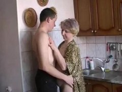 Russian moms Irina - having sex in the kitchen