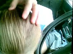 blonde sucking cock in the car