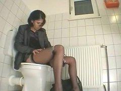 secretary enjoys herself during toilrt break